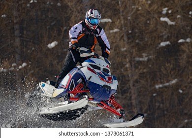 snowmobile jump in fresh snow