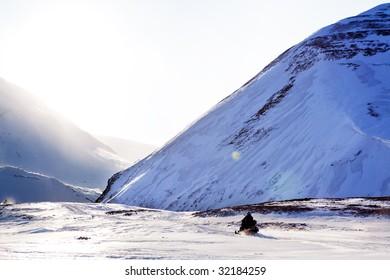 A snowmobile on a beautiful winter mountain landscape