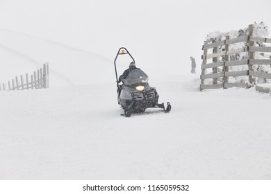 Snowmobile on the snow. White winter mountain landscape. Horizontal