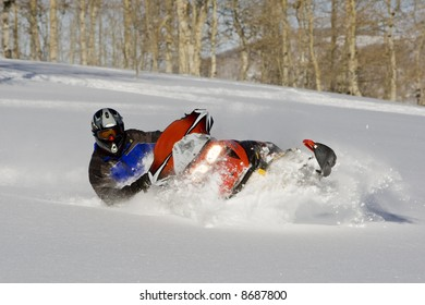 snowmobile in powder