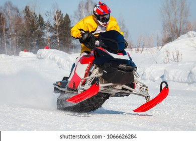 Snowmobile races jump in snow. Concept winter sports