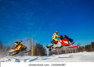 Snowmobile races jump in snow dust. Concept winter extreme sports