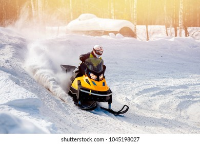 Snowmobile races in snow. Concept winter sports