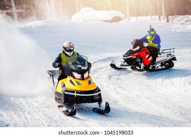Snowmobile races in the snow. Concept winter sports