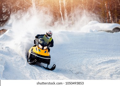 Snowmobile races in the snow. Concept winter sports, racers.