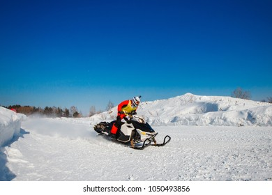 Snowmobile races in snow. Concept winter sports, racers.