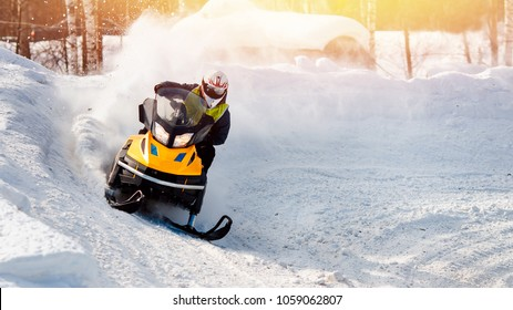Snowmobile races in snow. Concept winter sports.