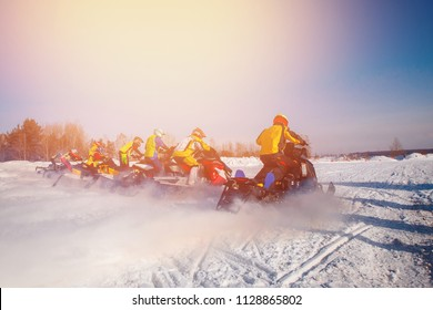 Snowmobile races start in snow. Concept winter extreme sports