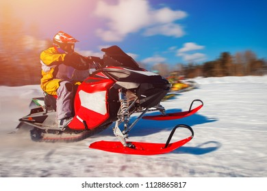 Snowmobile races start in snow. Concept winter sports