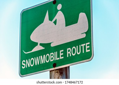 A Snowmobile sign indicating a snowmobile trail in the winter