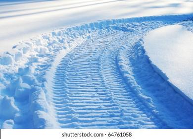 snowmobile track on snow