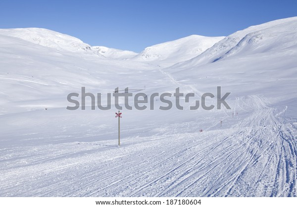 Snowmobile Tracks Nordic Mountains Red Cross Stock Photo (Edit Now