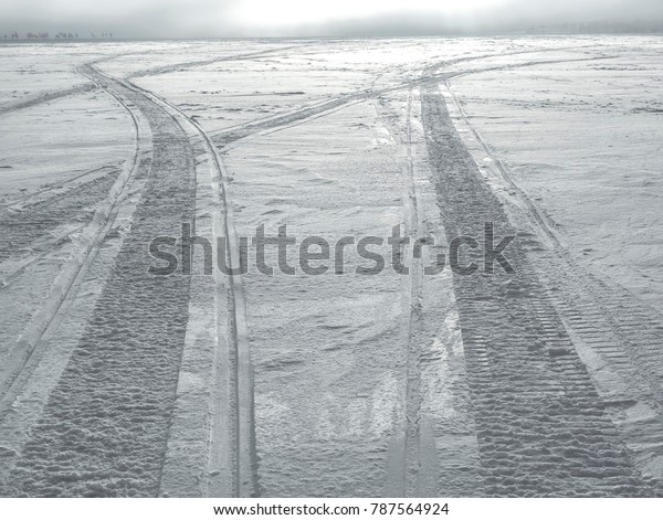 Snowmobile Tracks On Frozen Lake Stock Photo (Edit Now