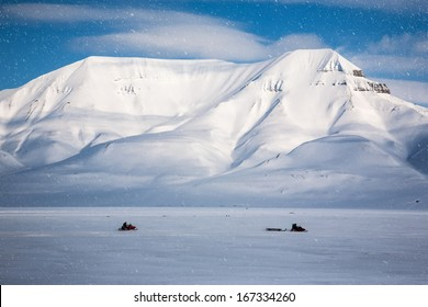 Snowmobiling, Wintry Landscape, Arctic North Pole, Svalbard.