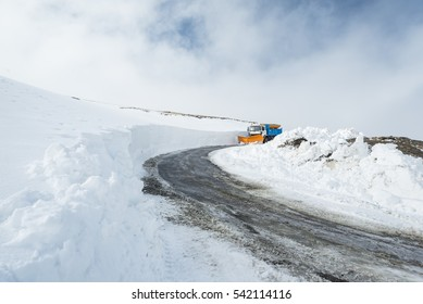 Snowplough working on a road