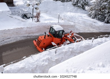 Snowplow in action on a road, top view