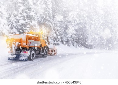 Snowplow cleared the snow-covered icy road