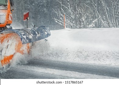 Snowplow truck removing dirty snow from city street or highway after heavy snowfalls. Traffic road situation. Weather forecast for drivers. Seasonal road maintenance