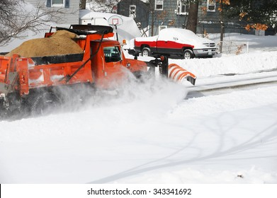 snowplow truck removing snow in the street