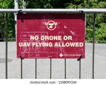 Snowqualmie, WA/USA-May 23, 2018: Puget Sound Energy posts a NO DRONE or UAV FLYING ALLOWED sign. PSE operates the hydroelectric power plant at Snowqualmie Falls in Washington state, USA.
