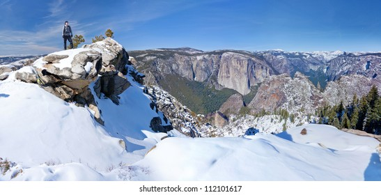 A Snowshoe hiker overlooking Yosemite National Park in winter