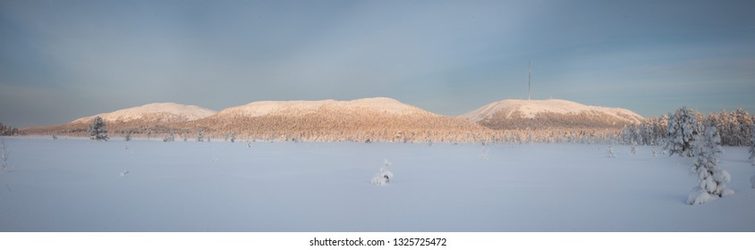 Snowshoeing on nature park with the beautiful fell landscape on Lapland, Finland