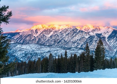 Snowshoeing tour at Purgatory Ski Resort.  Alpenglow at sundown on nearby Grizzly Peak.