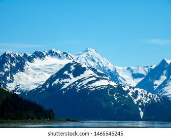 snowy Alaskan mountain range and water panoramic view