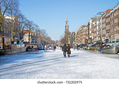 Snowy Amsterdam with the Westerkerk in the Netherlands in winter