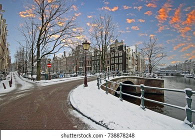 Snowy Amsterdam in winter in the Netherlands at sunrise