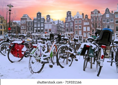 Snowy bikes in Amsterdam the Netherlands at sunset