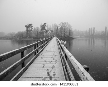 Snowy Boardwalk with Seagulls and Footprints
