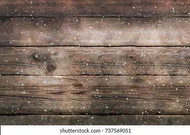 Snowy brown wooden background. Banner with copy space