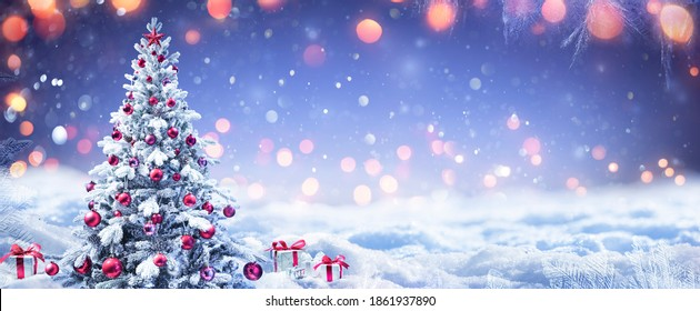 Snowy Christmas Tree With Red Ornament And Present Boxes In A Winter Landscape - Shutterstock ID 1861937890