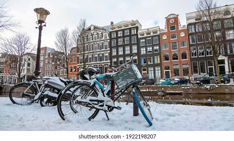 Snowy city Amsterdam in the Netherlands in winter