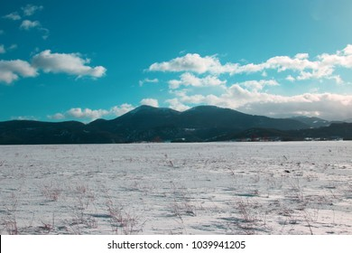 snowy countryside and cloudy and turquoise sky in Pyreness. Aude  in south of France