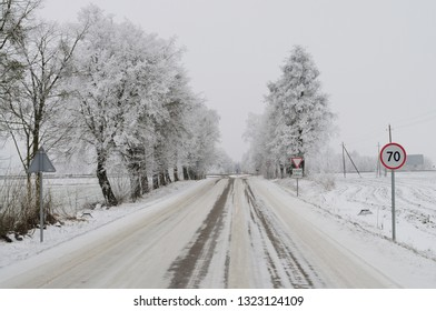 Snowy countryside road