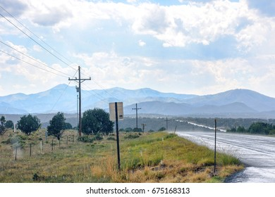 Snowy day in Ruidoso. View to road, signs and beautiful mountains. United states of America, New Mexico