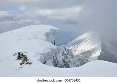 Snowy  eaves on the edge of the cliff on top of the mountain. Mountain peak Trem, Dry mountain, Serbia