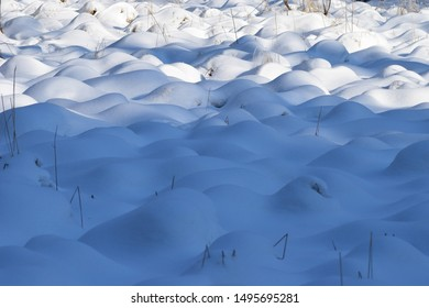 Snowy field with natural texture of humpbacks