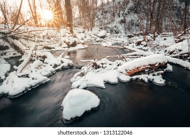 Snowy forest river sunset