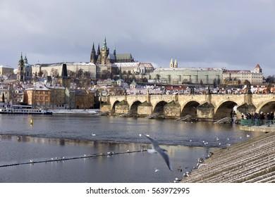 Snowy freeze Prague Lesser Town with gothic Castle and Charles Bridge, Czech republic