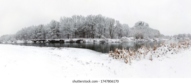 Snowy frosty river bank landscape at the woods - Shutterstock ID 1747806170