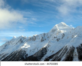 Snowy glacier and mountains in the Alps