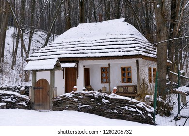Snowy house on the background of a winter landscape. Winter background.