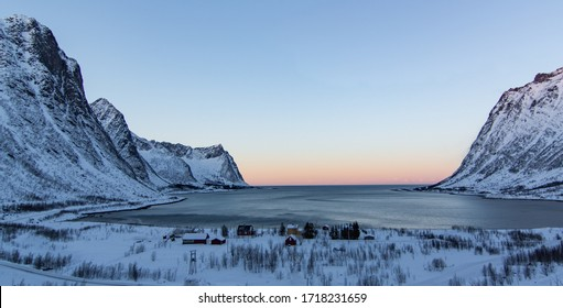 snowy and icy landscape in norway during winter in sunset