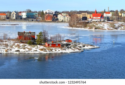 Snowy Islands of Helsinki archipelago on sunny spring day. Finland