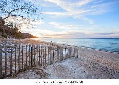 Snowy Lake Michigan beach at sunset