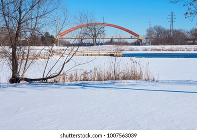 snowy lake rebecca park and bridges spanning mississippi river in hastings minnesota