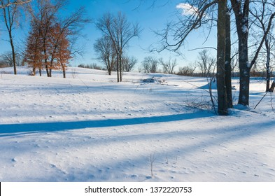 snowy landscape atop bluffs of battle creek regional park in saint paul minnesota